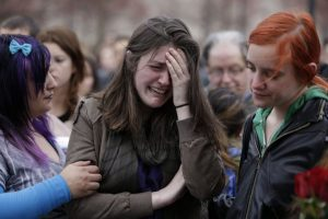 Emma MacDonald, 21, center, cries during a vigil for the victims of the Boston Marathon explosions at Boston Common, Tuesday, April 16, 2013. Twin explosions near the marathonís finish line Monday killed three people, wounded more than 170 and reawakened fears of terrorism. (AP Photo/Julio Cortez)     Emma MacDonald, 21, center, cries at a vigil for victims of the Boston Marathon bombings at Boston Common, April 16, 2013. (AP Photo/Julio Cortez)