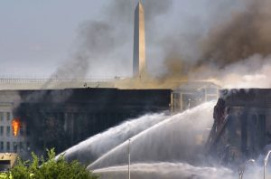 The Pentagon burns after a hijacked American Airlines flight crashed into it Sept. 11, 2001. (Reuters/Hyungwon Kang)