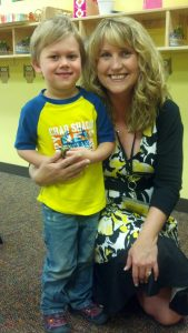 Noah and his lead teacher, Ms. Gina, on his last day of preschool, May 23, 2013. Photo by Kristina Cowan.