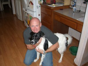 My brother and his dog, Bob, at home in 2009